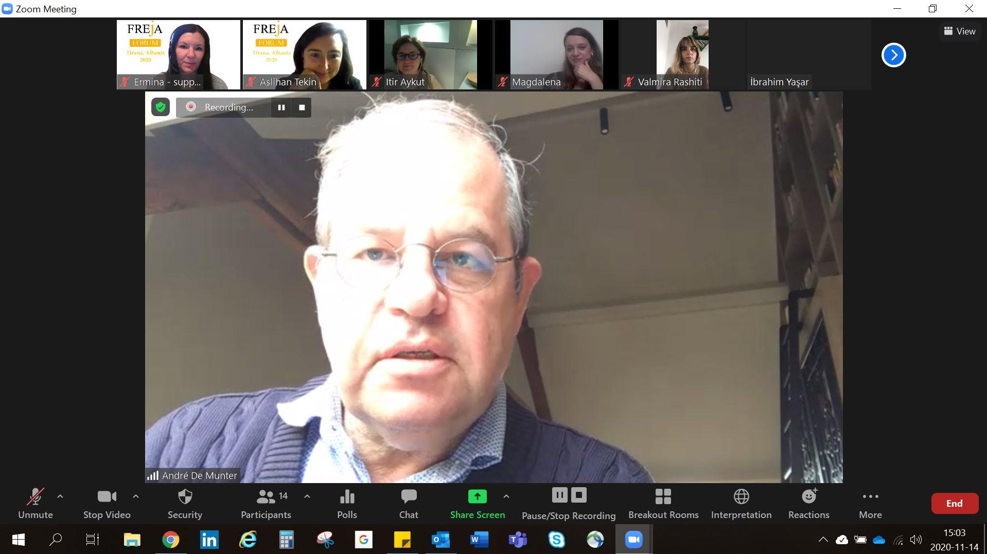 Man with glasses, at digital meeting, talking.